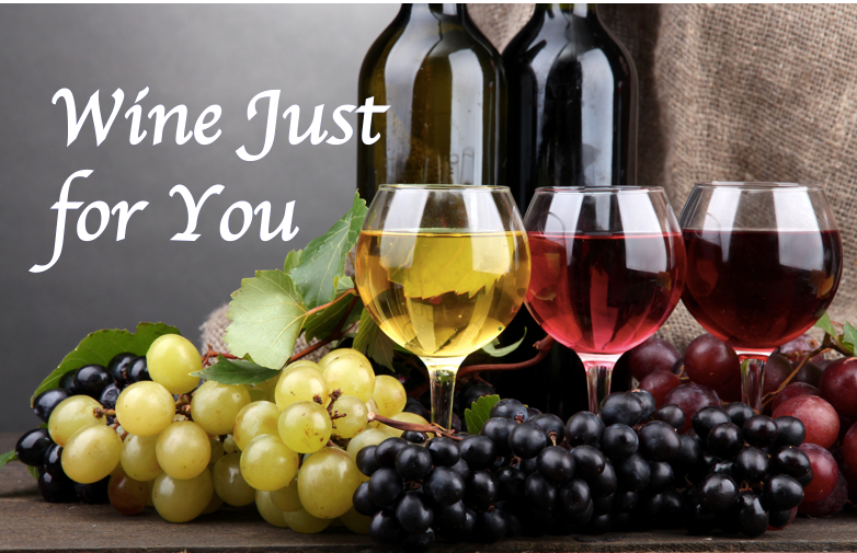 Picture of grapes and three wine glasses filled with a white, red, and rosé wines