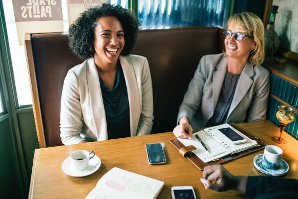 happy woman is more productive in the workplace