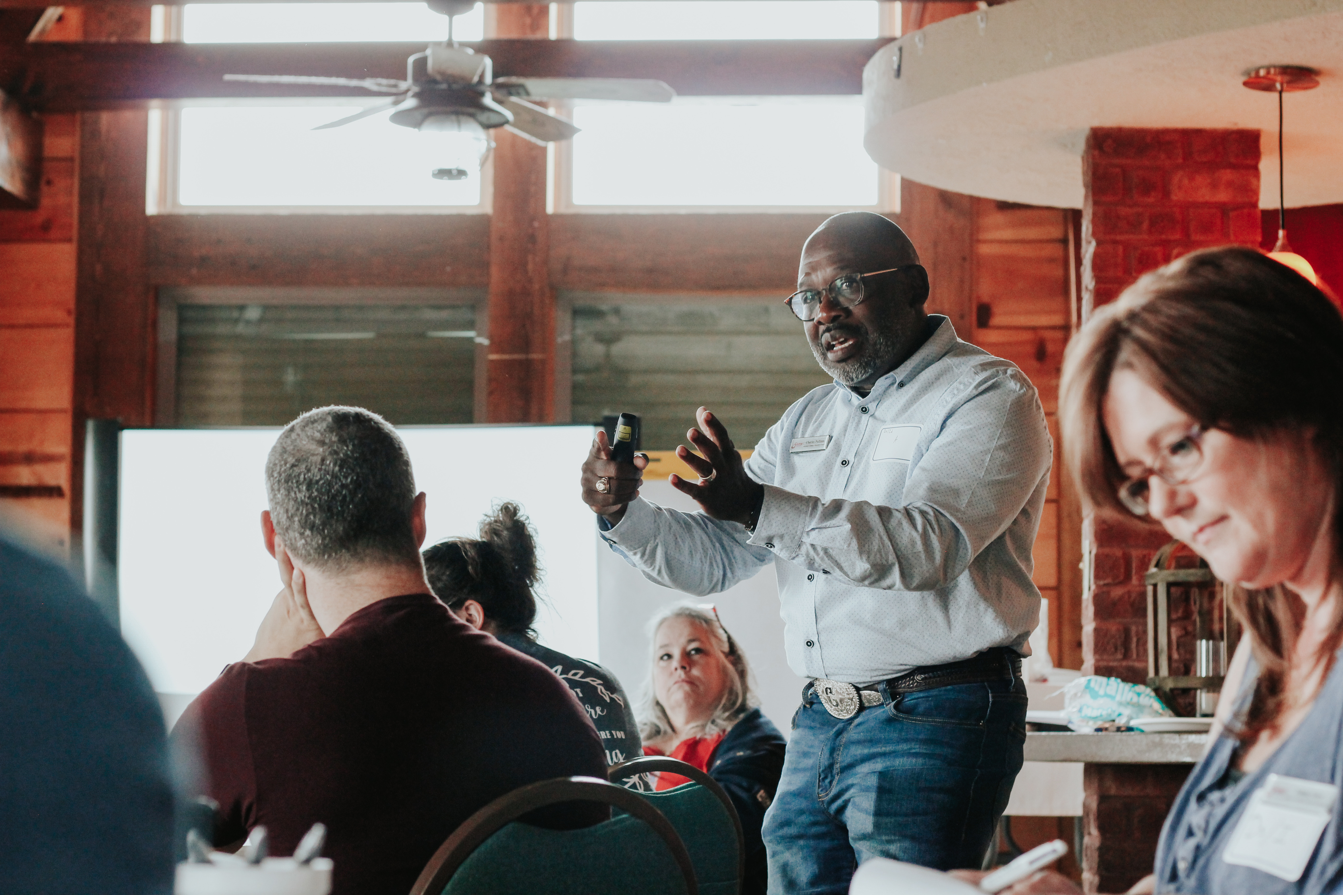 PHOTO: Charles Pulliam teaches amongst a group of people. Photo by Kristy Mapp.