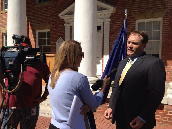Brennen Keene - former chairman - speaks to reporters on policy issues.jpg
