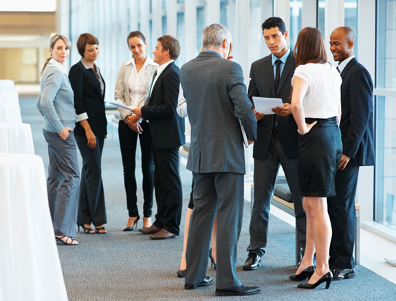 people networking at chamber business event