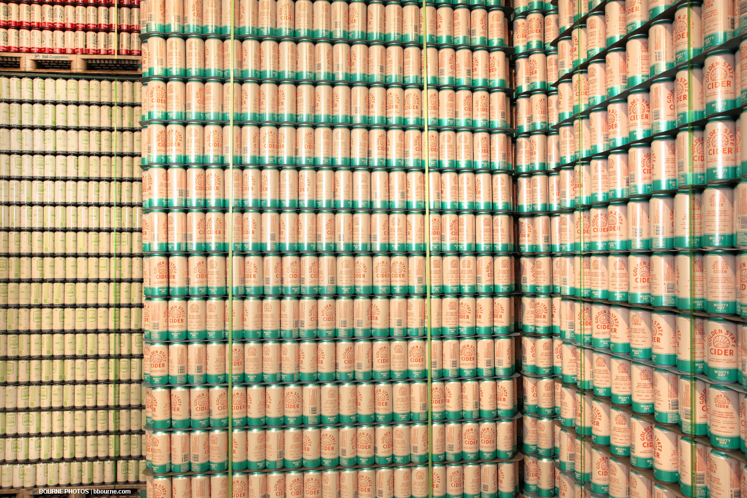 stacked cans of golden state cider on palettes