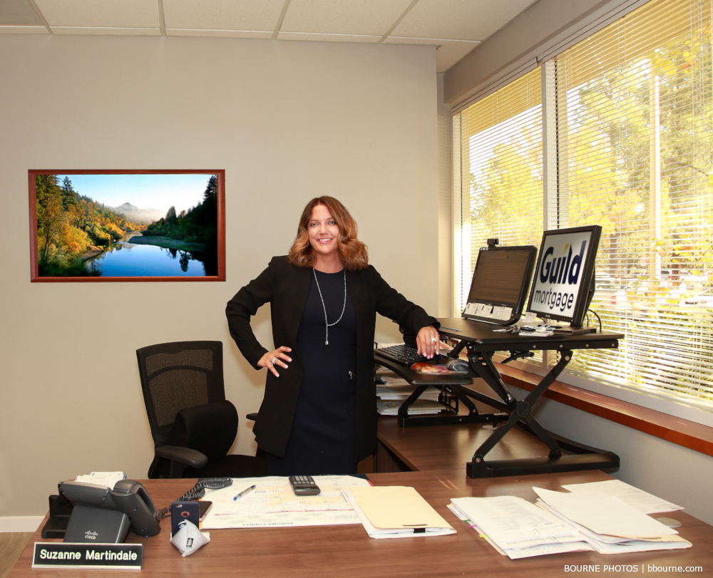 woman standing at her desk in her office