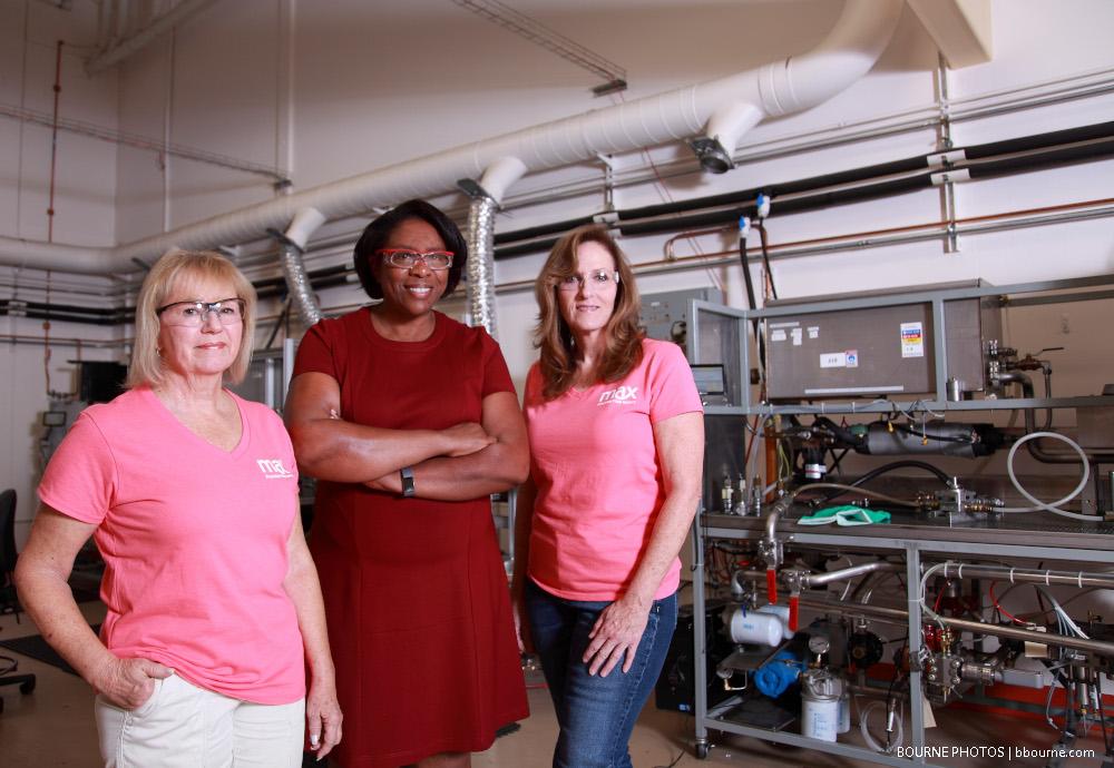 three women standing indoors at max machinery