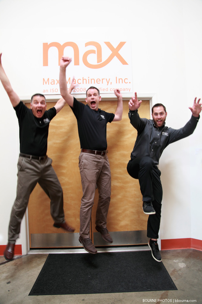 three men jumping indoors. max machinery