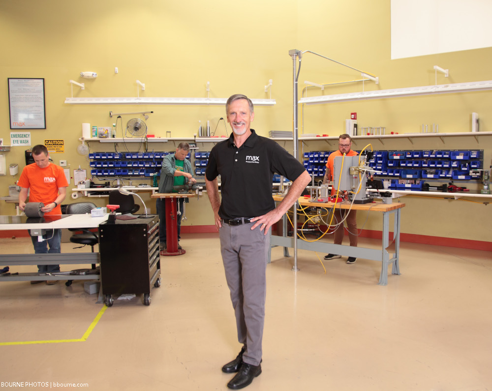 man standing indoors and max machinery lab