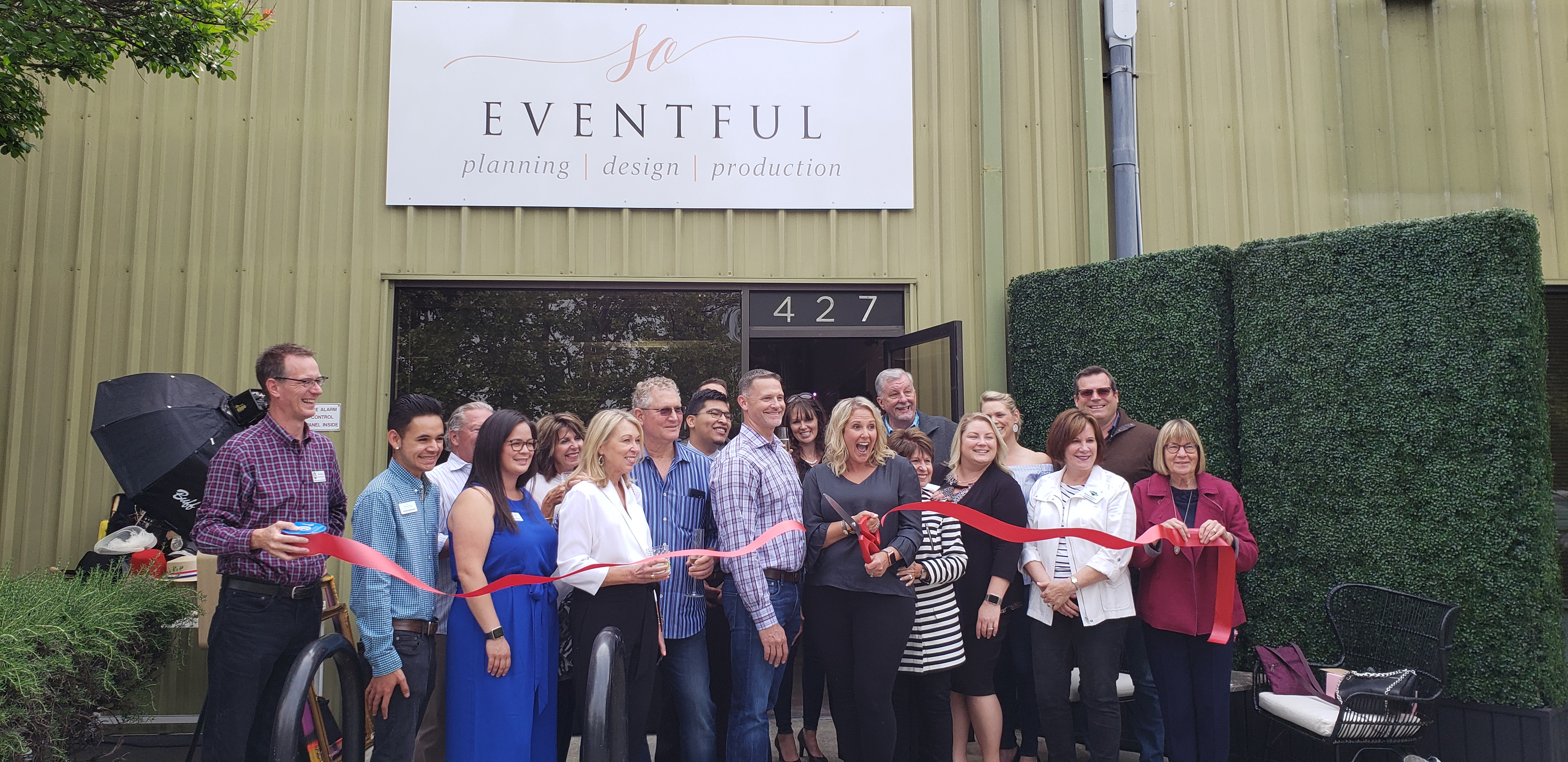 people gathered for a ribbon cutting ceremony outside of So Eventful's new location in Downtown Healdsburg.