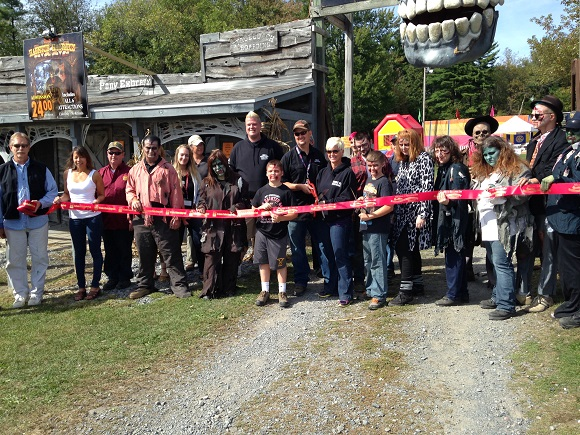 A ribbon cutting to Celebrate 25 Years of Fears at the Double M Haunted Hayrides.