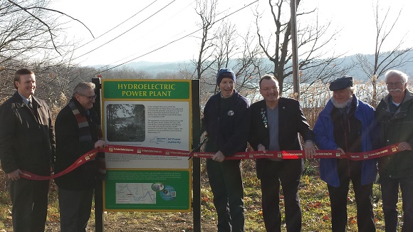 A ribbon cutting for Mohawk Towpath Byway unveiling of their new interpretive kiosk.