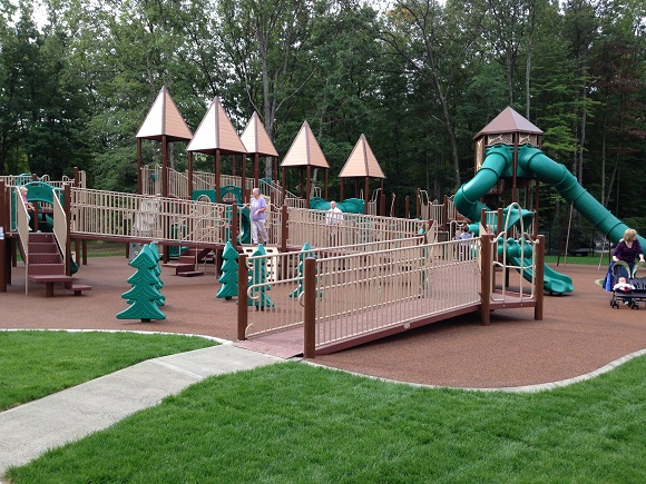 A ribbon cutting was held for the Grand Opening of the new playground in the Town of Milton, located inside Milton's Burgess Kimball Memorial Park on Woodthrush Court.