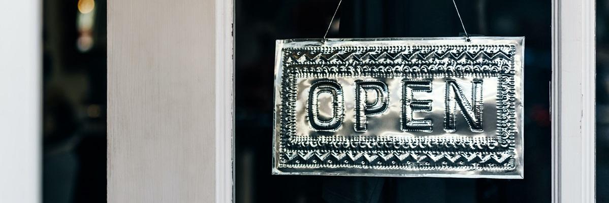 Silver open sign in window