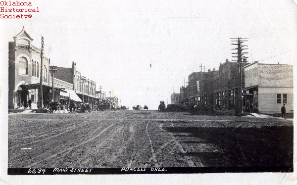 TOWNS---PURCELL---MAIN-STREET.-VIEW-LOOKING-EAST.-6634.-PRINTED-BY-J.-BOWERS-PHOTOGRAPHIC-CO..-LONDON-TOPEKA.-POST-CARD.jpg