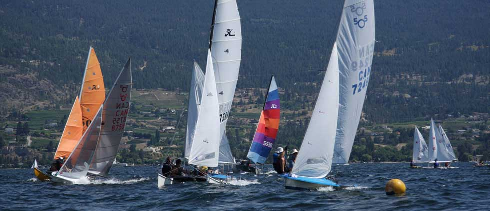 Yachts race over Okanagan Lake in Summerland BC.