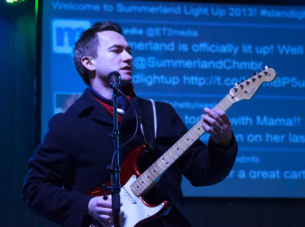 Musician onstage at the Festival of Lights in Summerland