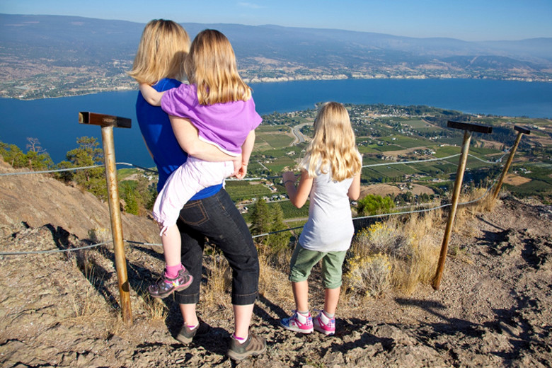 A mom and her two daughters take in the incredible view from Giant's Head Mountain.