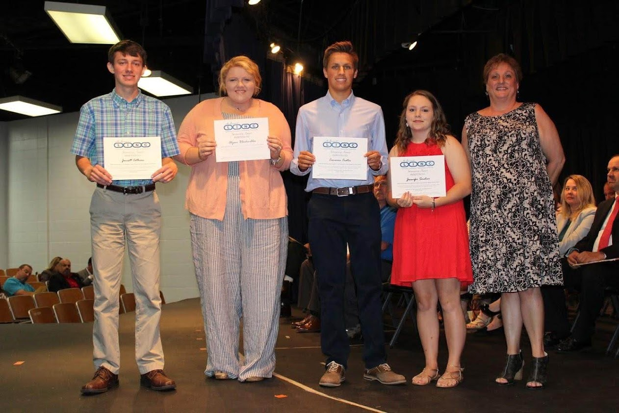 $500 Scholarship winners (L-R Jarrett Cothron, Alyson Blackwelder, Cameron Crater, and Jennifer Smelcer) with Amy Johnson