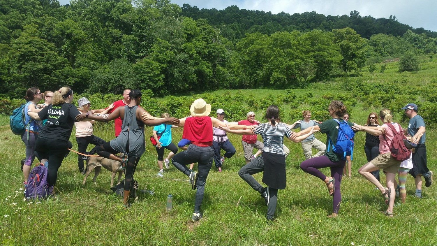 Visitors to the Orchard at Altapass enjoy some yoga and a hike.