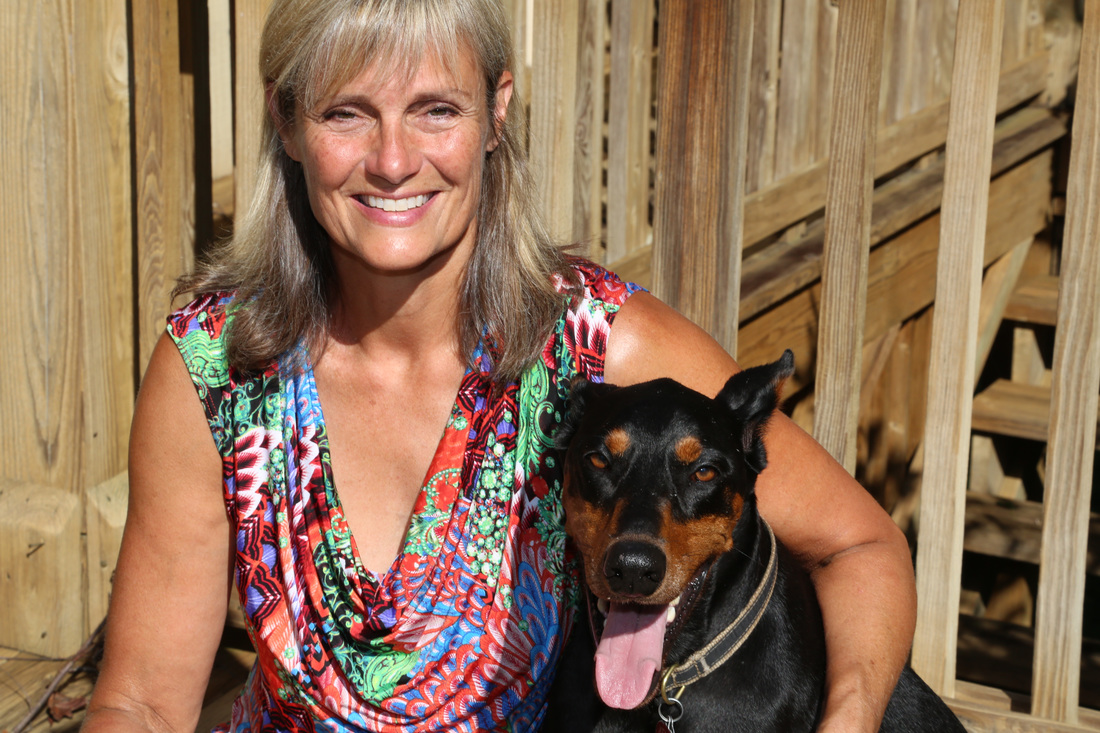 Lynn Carnes and her dog Xena.