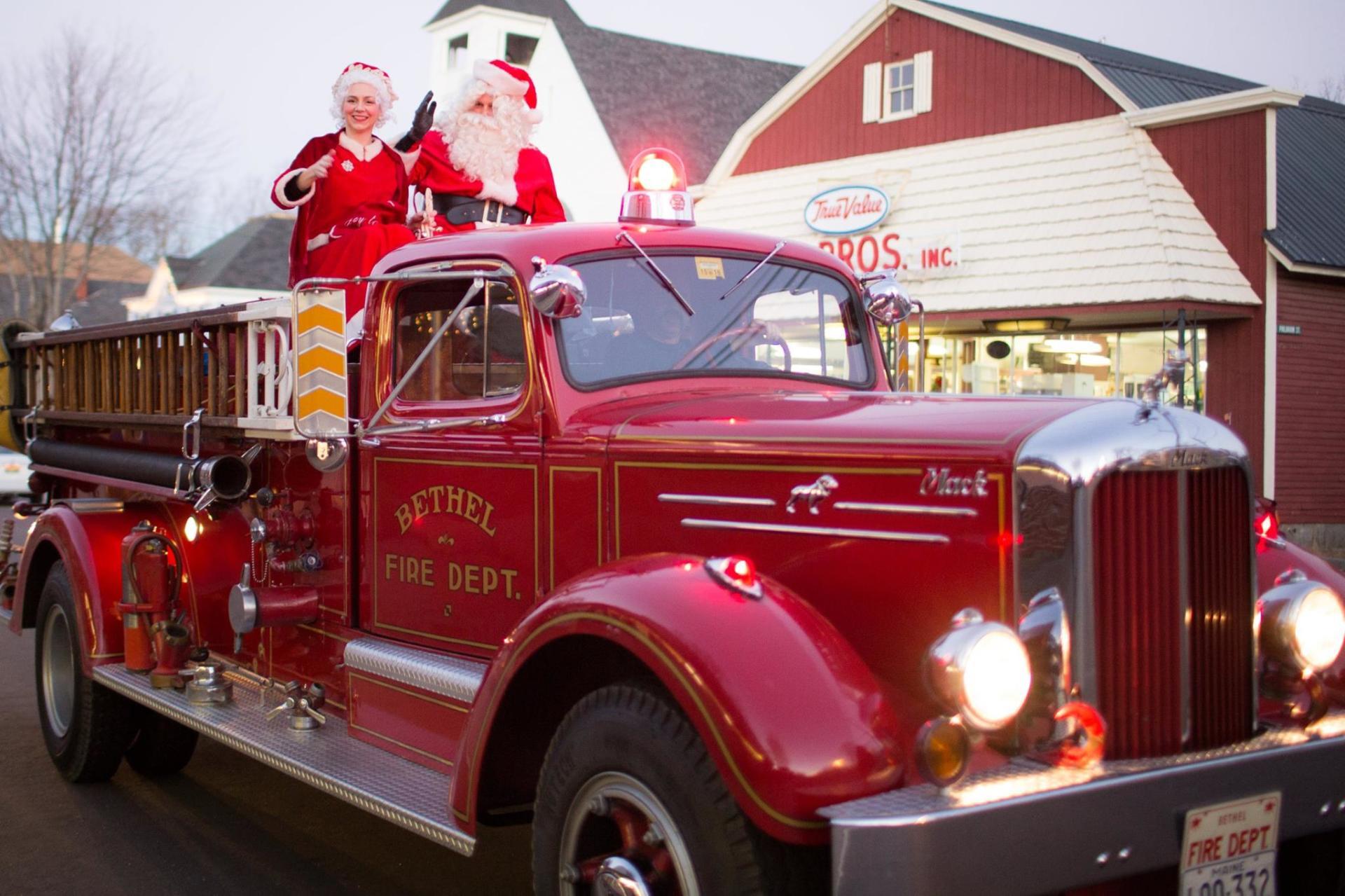 Santa-and-Mrs-Claus-on-firetruck-jingle-parade-Brooks-Bros.---Craig-Angevine-phto-w1920.jpg