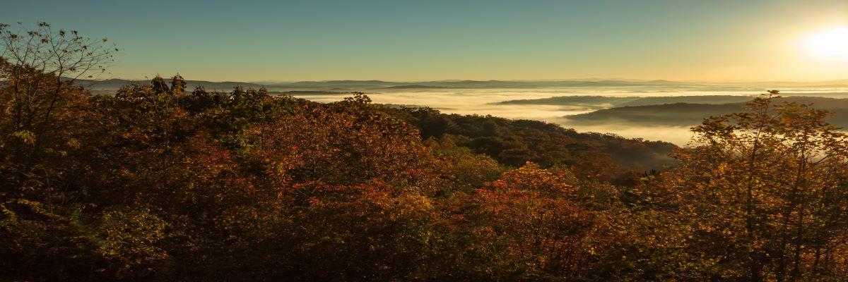 Tom-Stone-Sunrise-over-the-mountains-300dpi-Straight-Horizon-1200x400.jpg