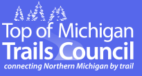 Top of Michigan Trails Council logo. Links to their website.