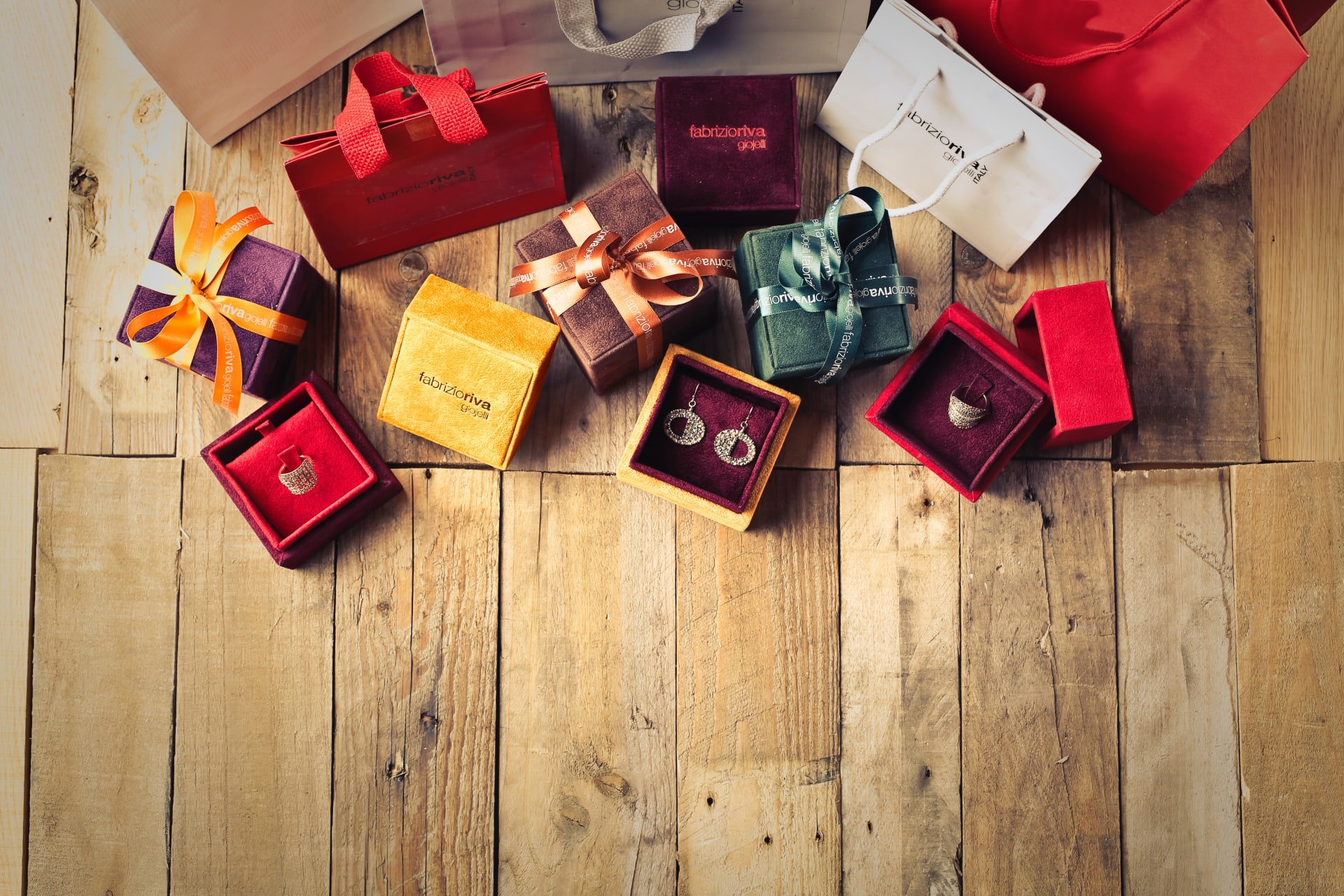 assorted-gift-boxes-on-brown-wooden-floor-surface-1050244-w1920.jpg