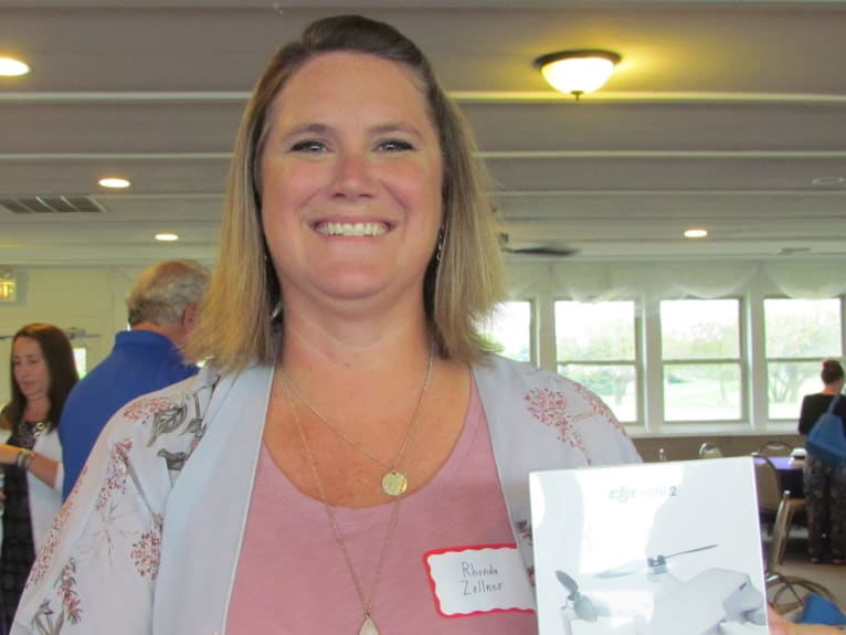 Door-Prize-winner-Rhonda-at-Chamber-monthly-meeting-August-w766.jpg