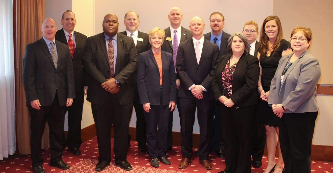 Board of Directors pictured from left to right: Henry Bass, Alan Fabian, Paul Mylum, Bill King, Mark Woolwine, Bif Johnson, James Creekmore, Margaret Galecki, Kevin Byrd, Cindy Rollison, Aaron Harris Kirby, and Terri Mauk.