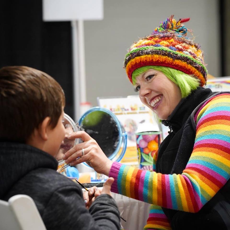 Kiki the Eco Elf paints faces during Spring Expo 2019. The Chamber hosted the community showcase at Kal Tire Place North March 8 and 9.