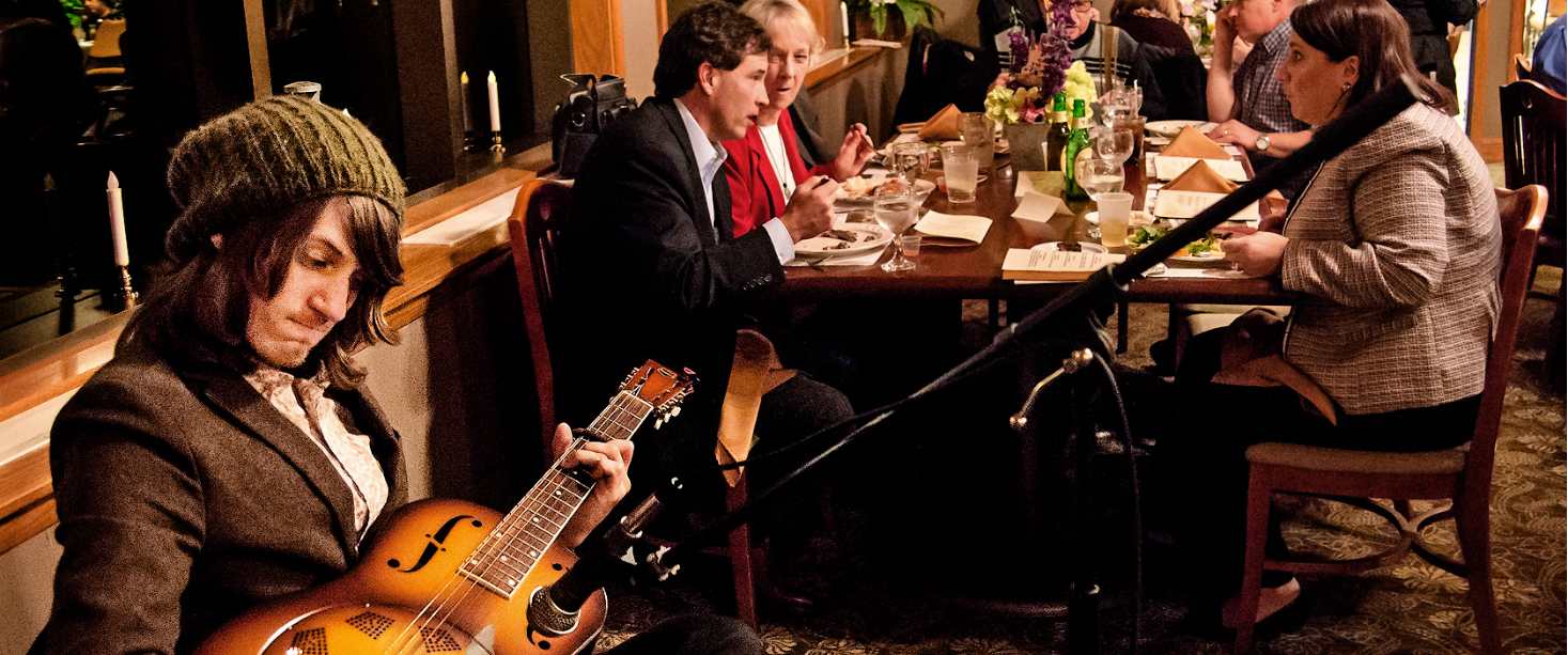 man-playing-guitar-at-a-dinner.jpg