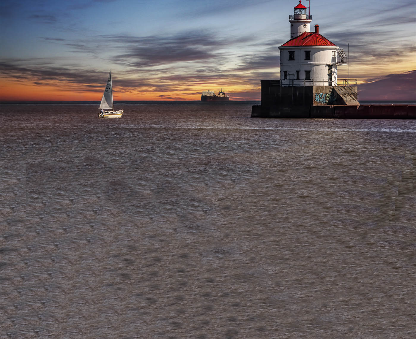 Supeior-Lighthouse-with-boats-(by-Joe-Polecheck).jpg