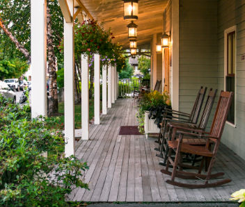 Relax in a rocking chair on hotel porch in Bar Harbor Maine