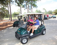 ladies enjoying a ride on a golf cart