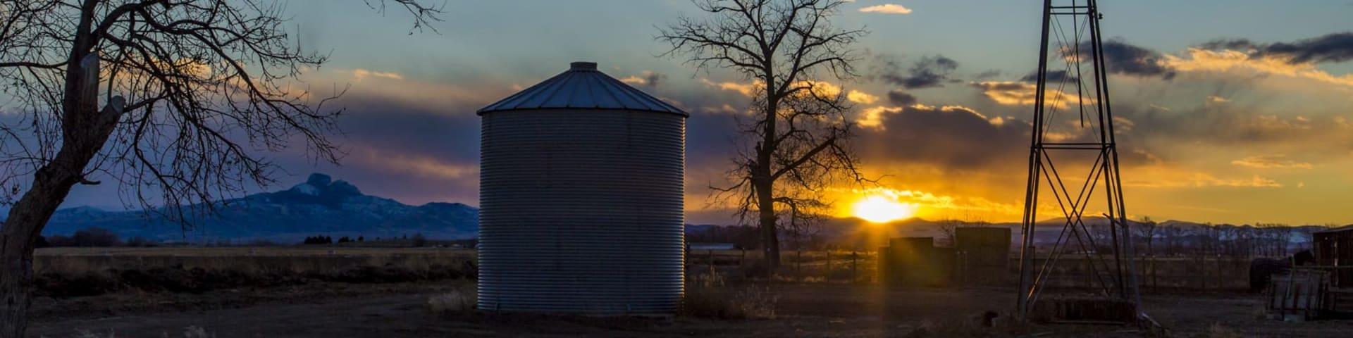 Image of a sunset over a farm