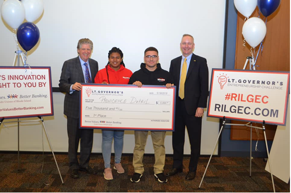 Lt. Governor McKee with Ron McLean, President/CEO of the Cooperative Credit Union Association, as they present a scholarship to the first place winners of the 2019 Lt. Governor's Entrepreneurship Challenge.