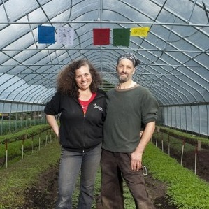 Deb-and-Ricky-in-greenhouse-Seeds-of-Solidarity.jpg