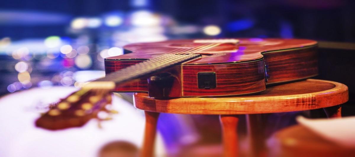 Concert-guitar-on-stage-w1200.jpg