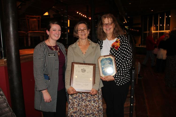 Tourism Manager presents Amy Lutzke and Ann Engelmann the 2018 awards for the Friends of Lorine Niedecker