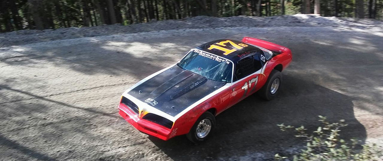Colorado Hill Climb Race car, number 17, red and black, sliding around a corner sideways.jpg