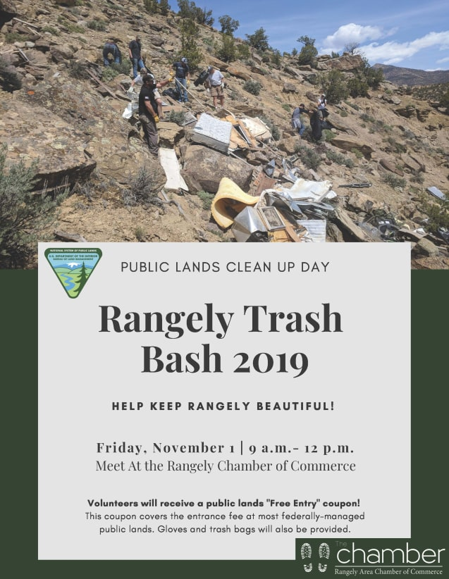 Rangely Trash Bash photo of people cleaning dumped trash from hillside.