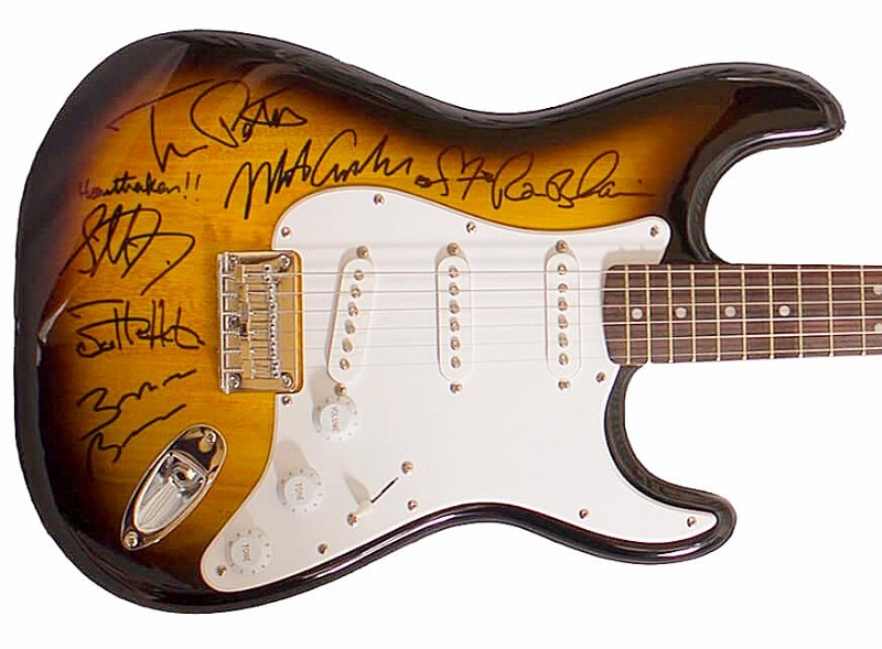 Guitar signed by Tom Petty and the Heartbreakers