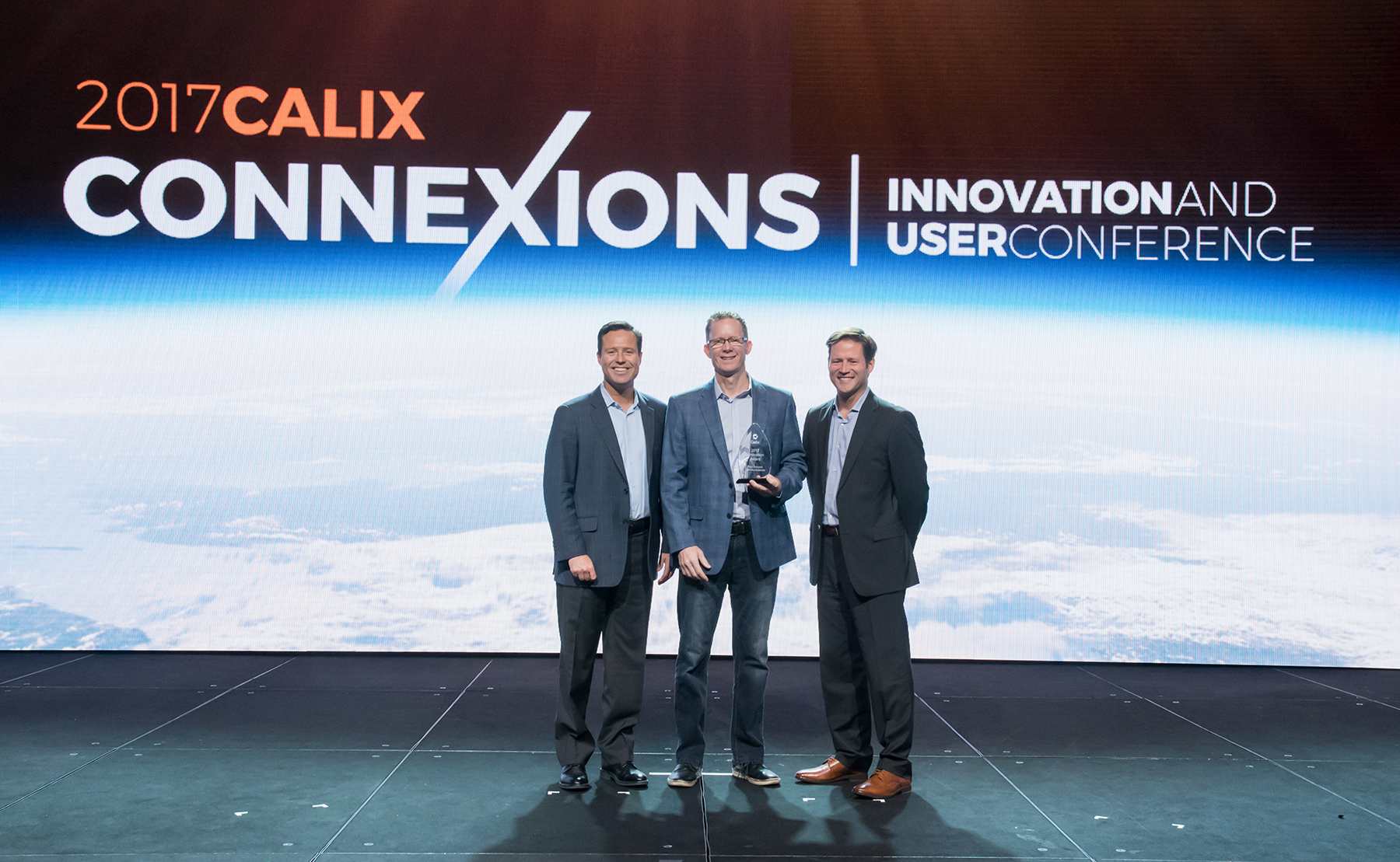 Pictured From L to R ? Matt Collins, Calix Chief Marketing Officer, Gary Johnson, Paul Bunyan Communications CEO/General Manager, Michael Weening, Calix Executive Vice President of Sales and Marketing