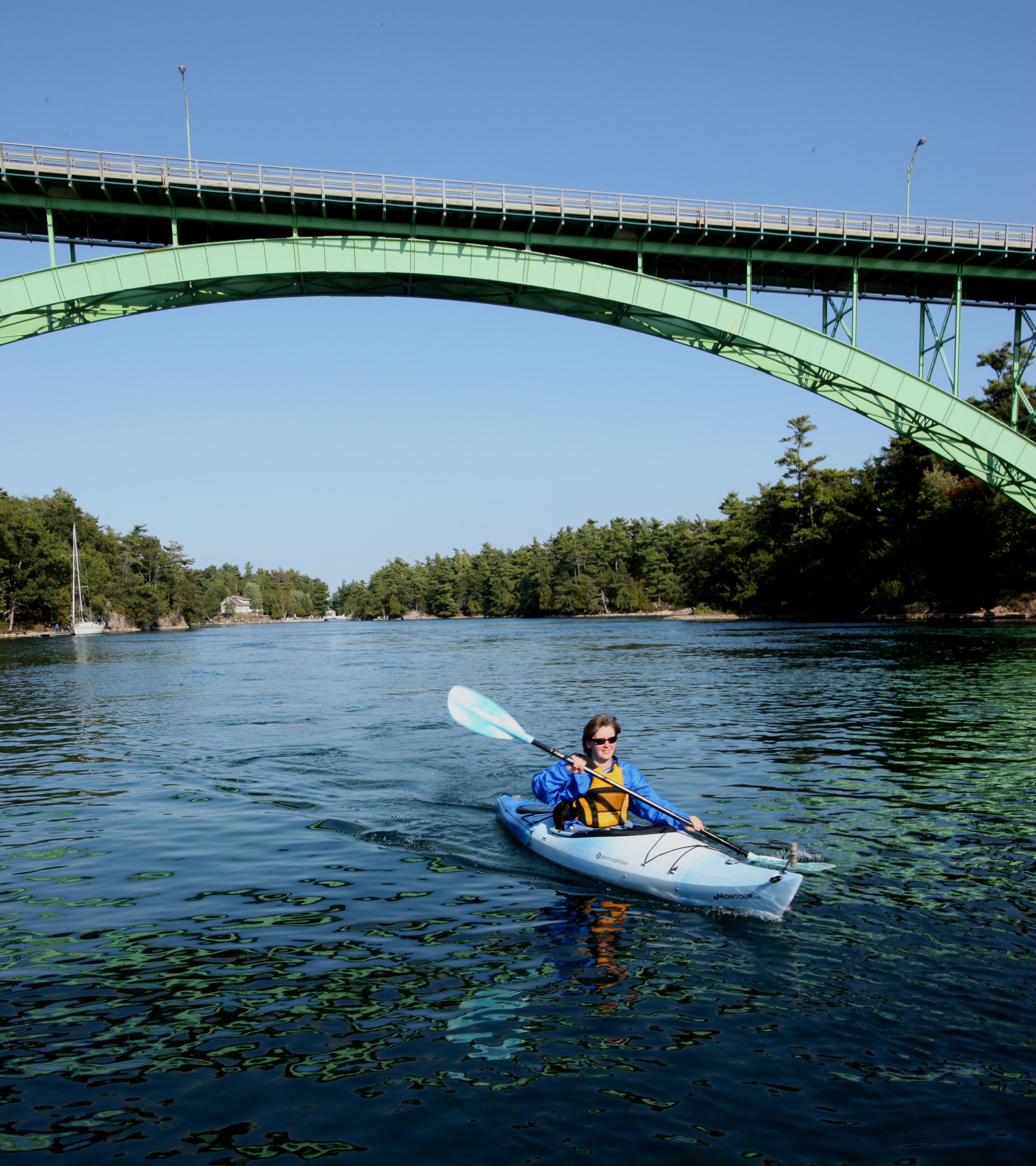 kayaking under bridge