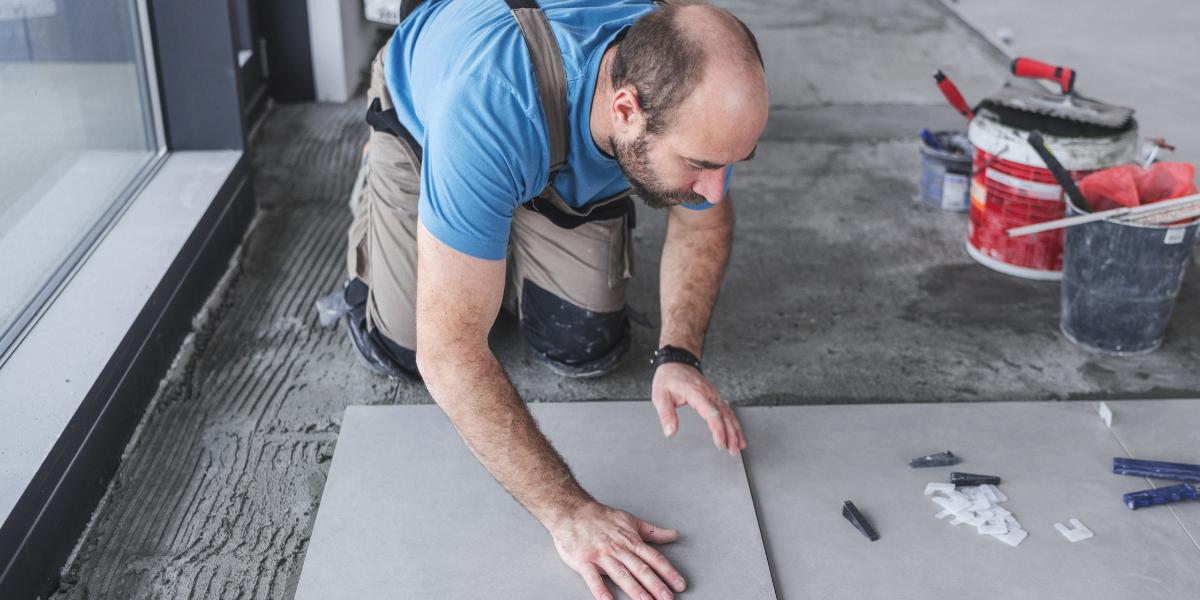 man installing tile floors