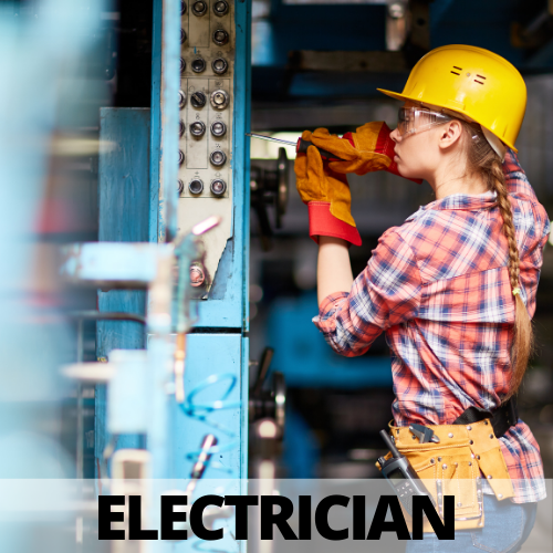 female construction electrician working on a circuit panel