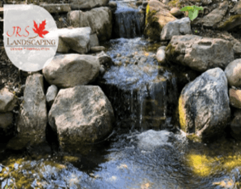 jrs landscaping logo with a rock waterfall and pond