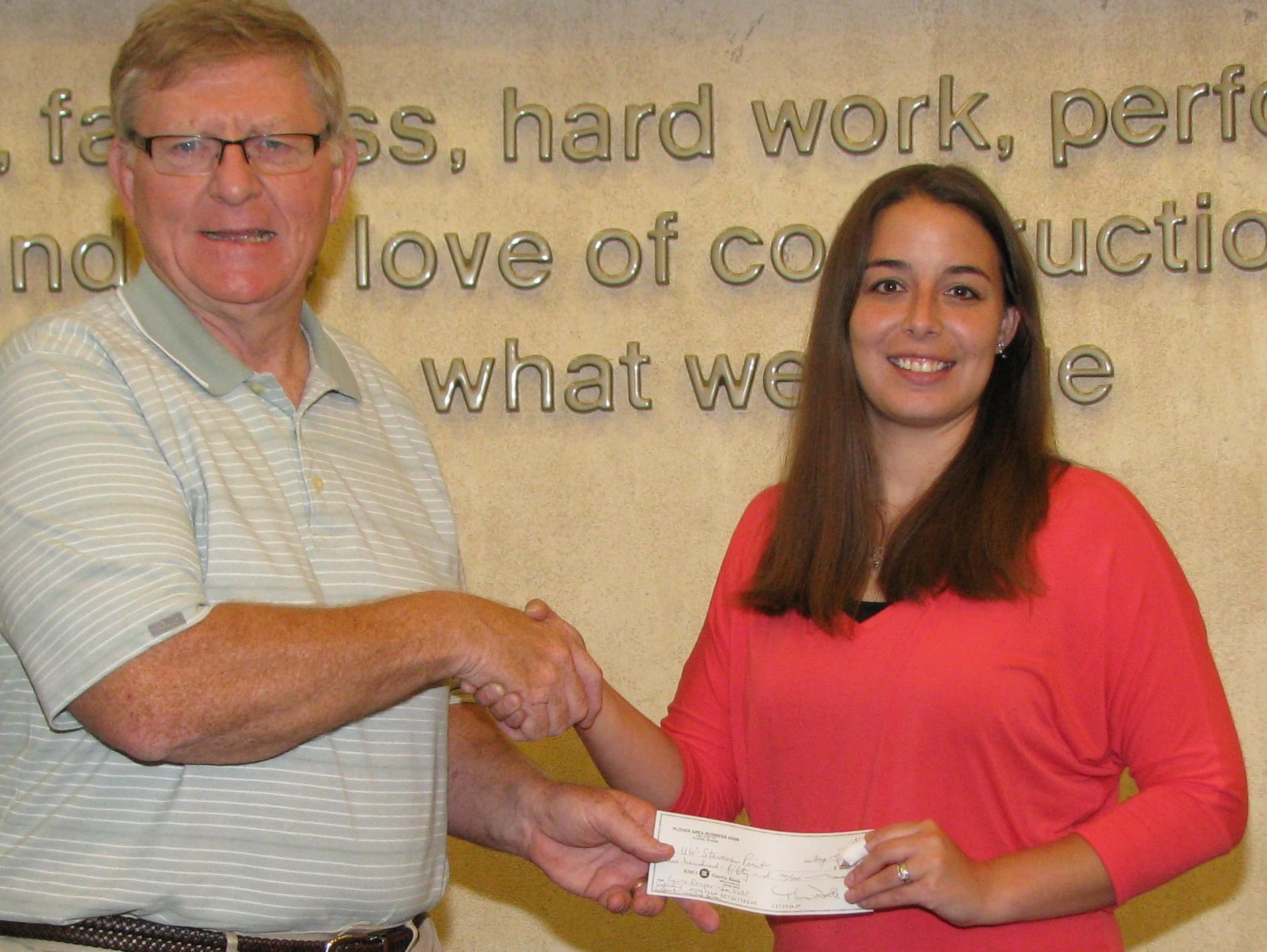PABA's Ken McKenzie presents Continuing Education Grant check to Laura Draper, The Boldt Company, for her continued participation in UWSP Leadership Certificate & Workshop Series.