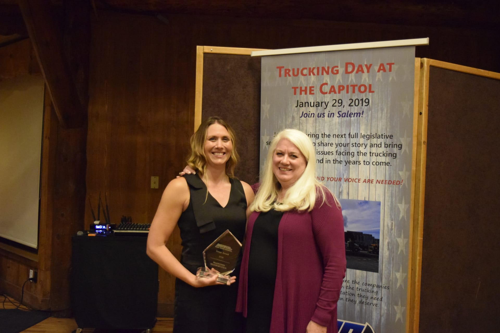 Jana Jarvis, OTA President poses with 2018 Image Award Winner, Tradewinds Transportation accepted by Heather Hayes