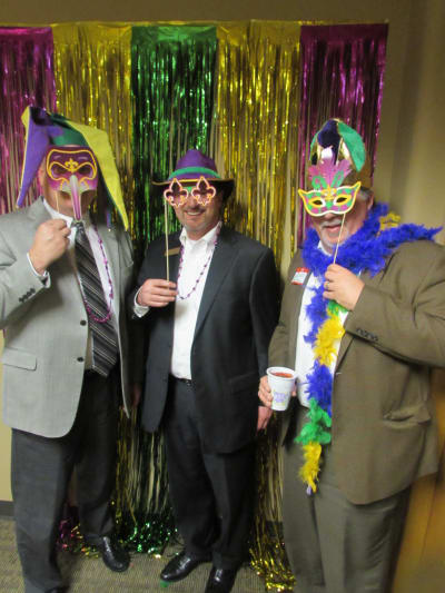 Three Mixer Attendors with mardi gras masks